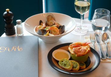 Enjoy a mini lobster souffle with a seafood bouillabasse at Souffle.